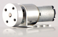 Mini gearmotor with bracket and hub.