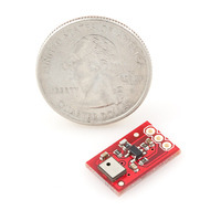 MEMS microphone breakout board with quarter for size reference.