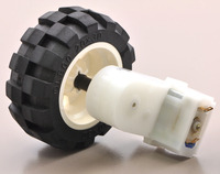2mm shaft adapter connecting a LEGO wheel to a 120:1 mini plastic gearmotor with offset output.