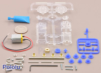 Parts included with the Tamiya 70188 mini motor gearbox (8-speed) kit with quarter for size reference.