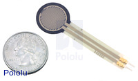 Force-sensing resistor (0.6″ circle) with US quarter for size reference.