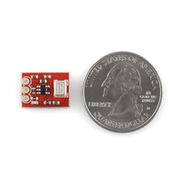 ADMP401 MEMS microphone carrier, top view with U.S. quarter for size reference.