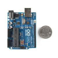 Arduino Uno DIP edition with U.S. quarter for size reference.