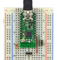 Wixel on breadboard with a bootloader button and reset button connected.