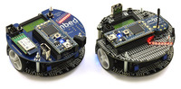 ARM's original m3pi (left) next to Pololu's m3pi robot (right).