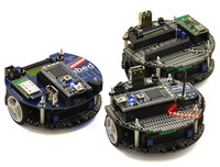 Fleet of m3pi robots: ARM's original m3pi (left) and Pololu's m3pis (right).