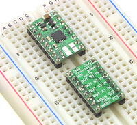 Two DRV8833 dual motor driver carriers plugged into a breadboard.