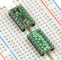 Two DRV8835 dual motor driver carriers plugged into a breadboard.