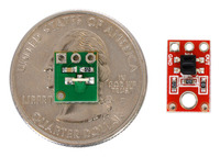 QTR-L-1RC reflectance sensor on a quarter next to a QTR-1A reflectance sensor.