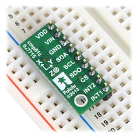 LSM303D 3D compass and accelerometer carrier with voltage regulator in a breadboard.