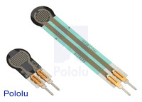 0.25″-diameter short-tail force sensing resistor (FSR) next to a 0.2″-diameter FSR with a standard tail.