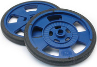 Solarbotics GMPW blue plastic wheel with molded tire and encoder stripes.